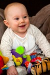 smiling-baby-with-toys