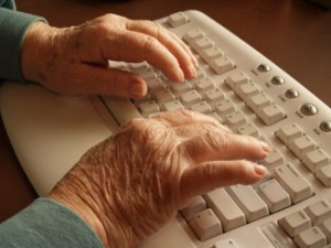 img-seniors-hands-typing-at-keyboard